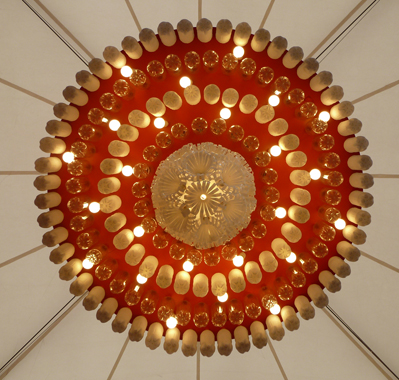 Chandelier made from upcycled coke bottles by sarah turner upcyclist commissioned by coca cola uk artist sarah turner has created a series of chandeliers and a sculpture made from coca cola bottles for the olympics centre in aloadofball Images