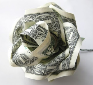 Paper rose made from one dollar bills